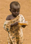 photo of child with dirty water